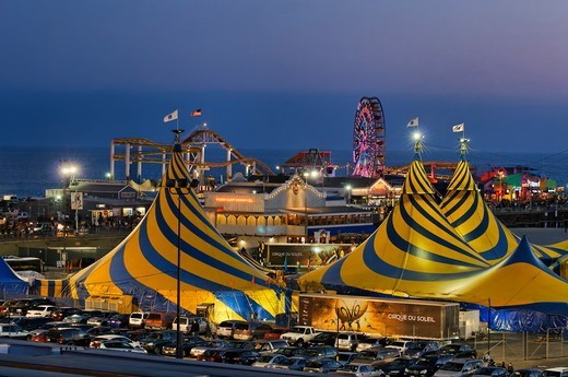 USA, California, Santa Monica, Striking blue and yellow tent tops of Cirque du Soleil, adorning Santa Monica Beach next to Santa Monica Pier, during their stay 2011 and 2012 : Stock Photo