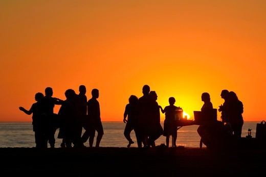 USA, California, Los Angeles, Westchester, Santa Monica Bay, People dancing and celebrating on beach at sunset : Stock Photo