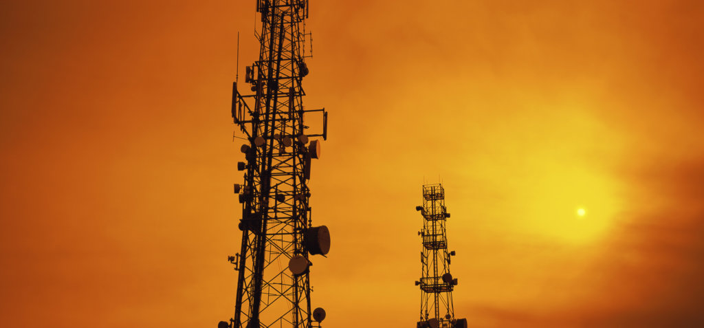 Silhouette of radio towers : Stock Photo