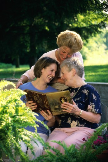 Stock Photo: 637R-301 Daughter sitting in a park with her mother and grandmother