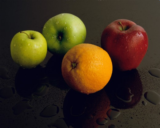 Stock Photo: 637R-383 Close-up of apples and an orange