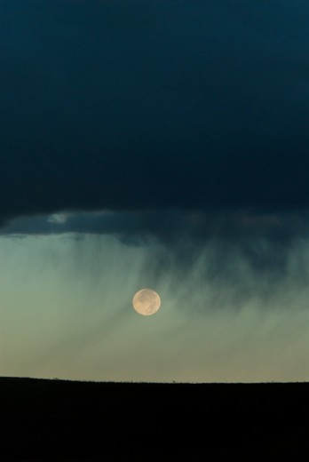 Rainclouds with moon beneath. South Dakota : Stock Photo