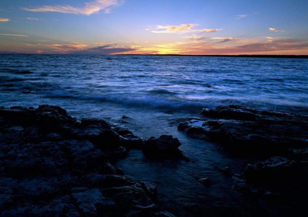 Sunset over a lake, Dorcas Bay, Lake Huron, Ontario, Canada : Stock Photo