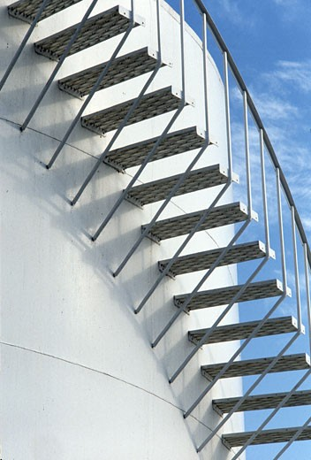 Staircase outside of a fuel storage tank : Stock Photo