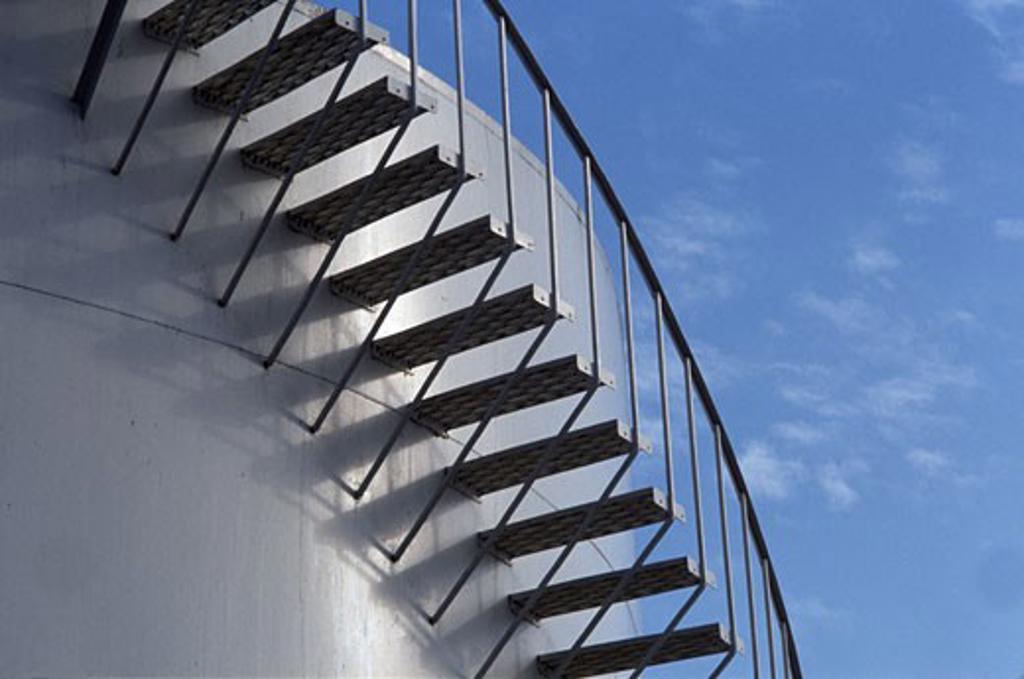 Staircase outside a fuel storage tank : Stock Photo