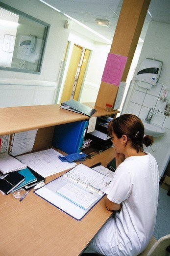 Stock Photo: 824-100813 NURSE WITH PATIENT´S RECORD. NURSE WITH PATIENT´S RECORD Photo essay. Chatellerault Hospital (Camille Guérin Hospital) in the French department of Vienne.