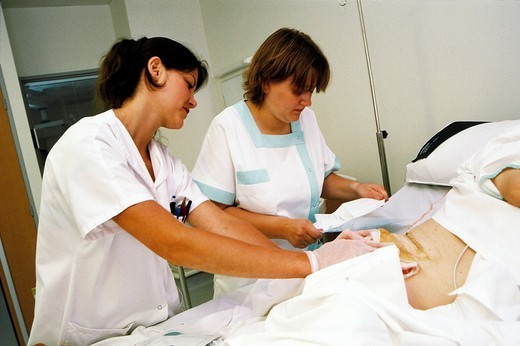 Stock Photo: 824-100815 STUDENT NURSE DISPENSING CARE. STUDENT NURSE DISPENSING CARE Photo essay. Chatellerault Hospital (Camille Guérin Hospital) in the French department of Vienne.