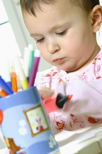 CHILD INDOORS DRAWING. CHILD INDOORS DRAWING Model. : Stock Photo