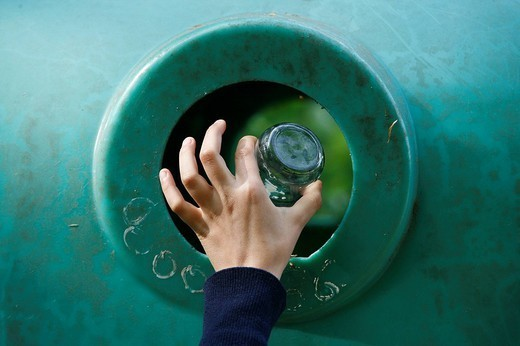 REFUSE COLLECTION. REFUSE COLLECTION Child throwing a pot ade glass in a separating trash. : Stock Photo