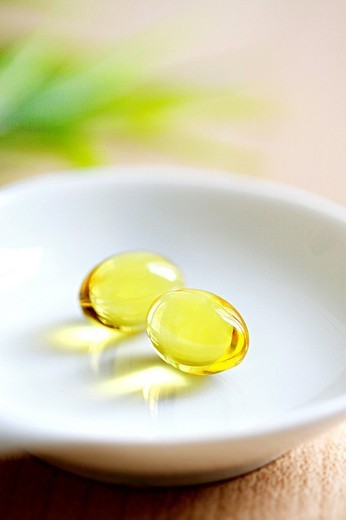FOOD SUPPLEMENT. FOOD SUPPLEMENT Capsules of evening primrose. : Stock Photo