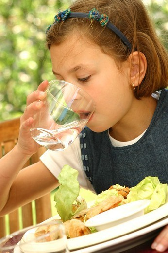 CHILD EATING A MEAL. CHILD EATING A MEAL Model. 9-year-old girl. : Stock Photo