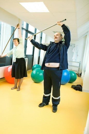 GYMNASTICS. Photo essay at the hospital of Meaux 77, France. Department of internal medicine : Diabetology _ Endocrinology _ Hypertension. Dietetic workshop. Session of gymnastics for the patients. : Stock Photo