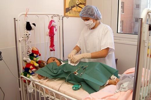 ASEPSIS. ASEPSIS Photo essay. Necker Hospital for Children in Paris, France. Preparing child suffering immune deficiencies to enter sterile bubble. : Stock Photo