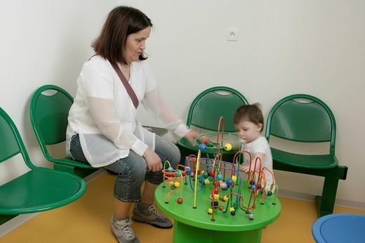 Stock Photo: 824-110471 HOSPITAL WAITING ROOM. HOSPITAL WAITING ROOM Photo essay at the hospital of Meaux 77, France. Waiting room of the pediatrics department.