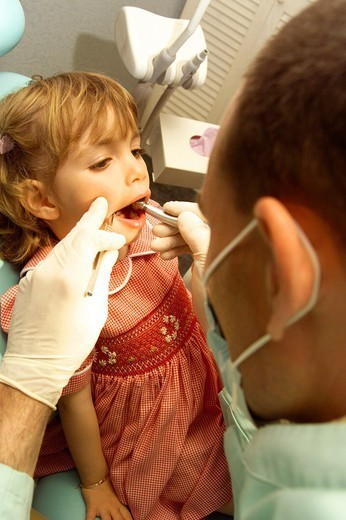 CHILD RECEIVING DENTAL CARE. CHILD RECEIVING DENTAL CARE Models. : Stock Photo