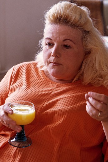 Stock Photo: 824-112311 WOMAN WITH A DRINK. WOMAN WITH A DRINK Model.