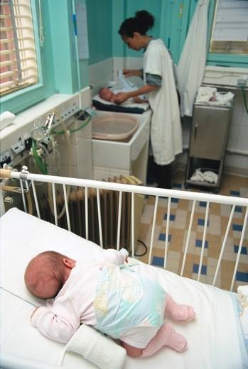 INFANT HOSPITAL PATIENT W. NURSE : Stock Photo
