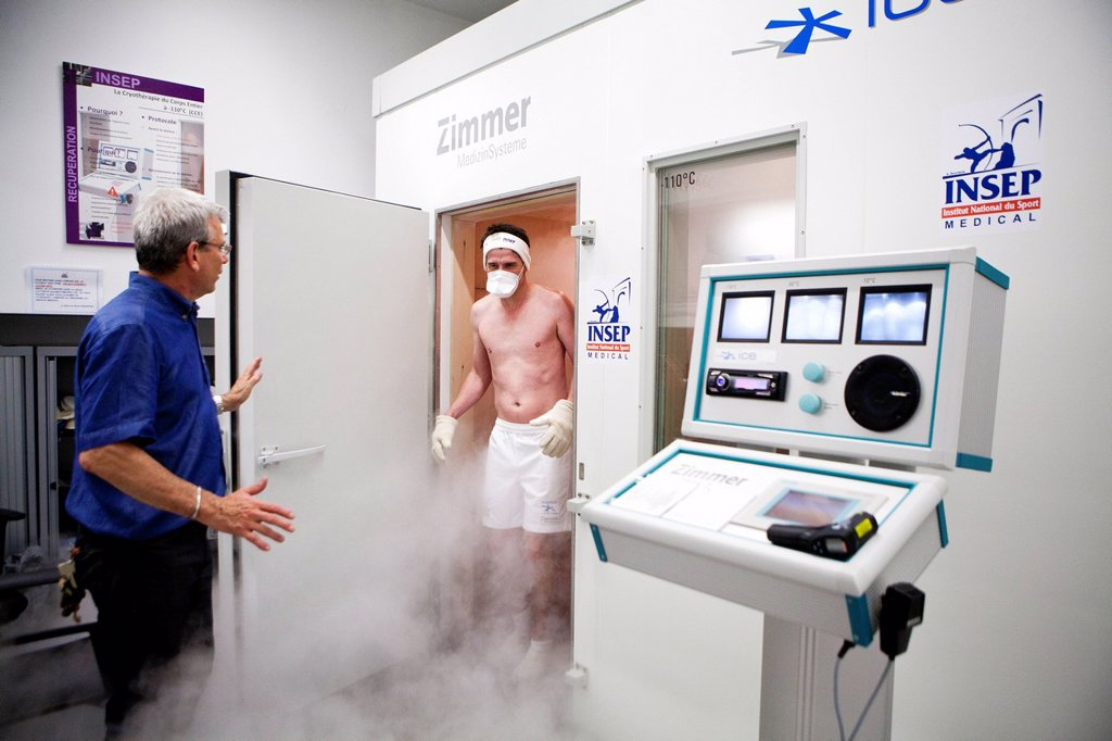 Stock Photo: 824-114747 WHOLE BODY CRYOTHERAPY. Photo essay on the Whole Body Cryotherapy at INSEP National institute of sport in France. Whole Body Cryotherapy is the stimulating use of extremely low temperatures below minus 110°C. The therapy stimulates the temperature receptors in the skin to communicate with the brain. The brain then transmits messages throughout the body causing the peripheral blood vessels to constrict. The enhanced blood supply that Whole Body Cryotherapy stimulates increases the oxygen and nutr