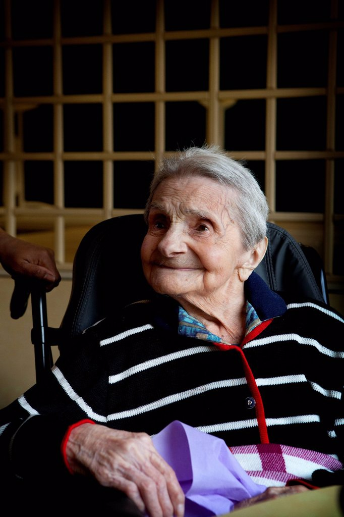 Stock Photo: 824-116508 CENTENARIAN. Marguerite is 110 years old, her family is made up of 5 generations and she knows her great, great grand children. She worked until she was 76 and it was only when she was 101 that she went into a retirement home.