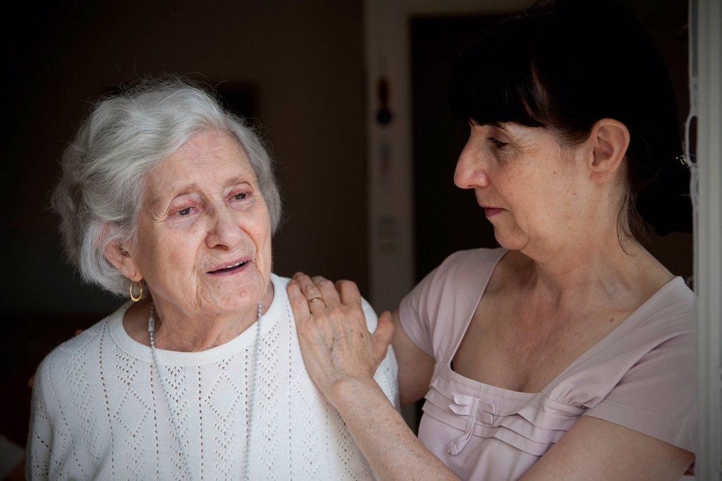 ELDERLY PERSON INDOORS : Stock Photo