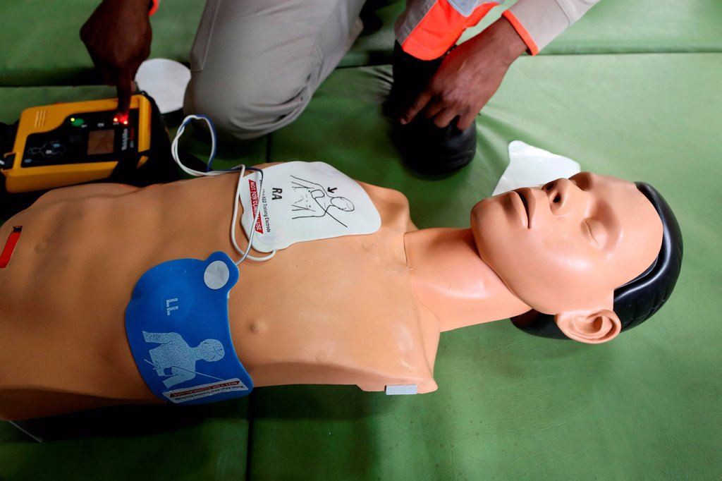 FIRST AID. Workshop organised by the Red Cross. Life_saving first aid on a model. Defibrillator. : Stock Photo