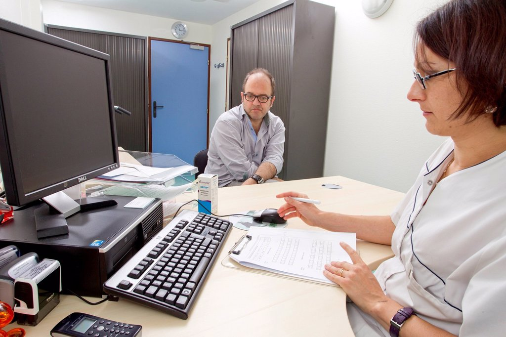 Stock Photo: 824-118028 MULTIPLE SCLEROSIS, CONSULTATION. Clinical research in the GHICL. General neurology department at St Vincent de Paul hospital in Lille, France. A patient suffering from multiple sclerosis in its primary progressive form. A mental calculation test.