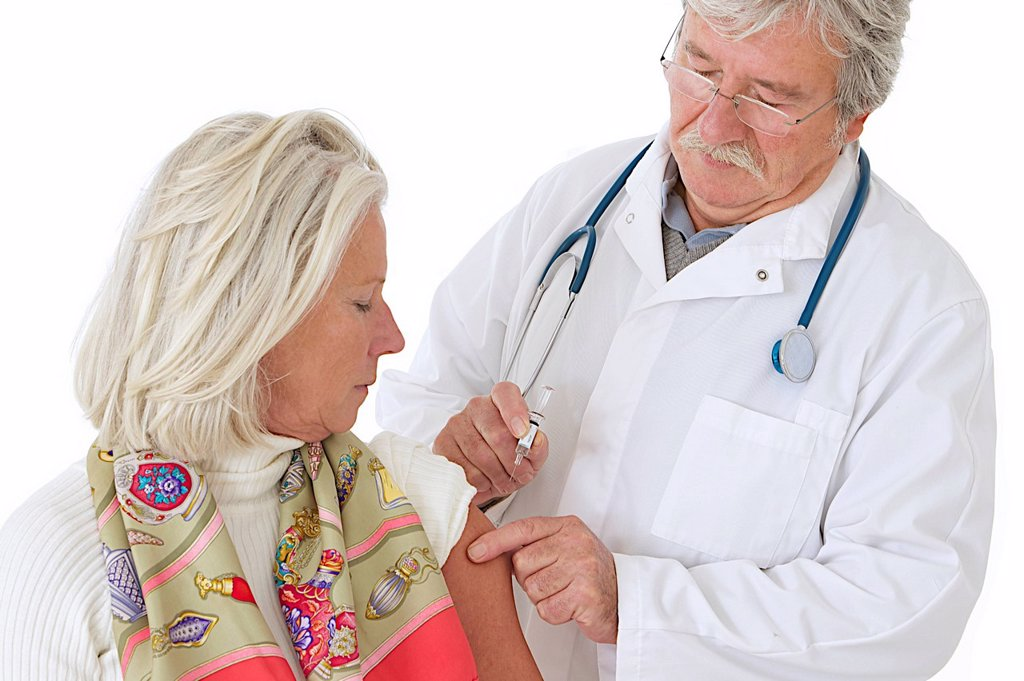 VACCINATING AN ELDERLY PERSON : Stock Photo