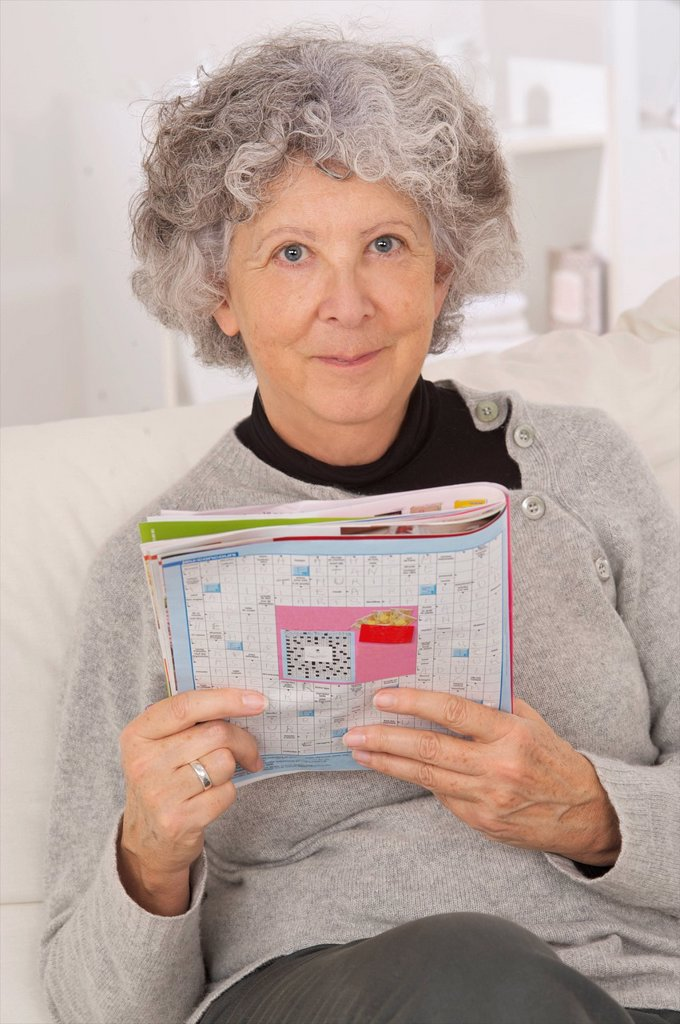 ELDERLY PERSON READING : Stock Photo
