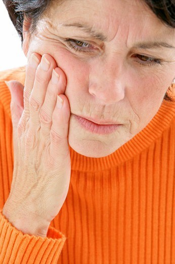 ELDERLY PERSON WITH A TOOTHACHE. ELDERLY PERSON WITH A TOOTHACHE Model. : Stock Photo