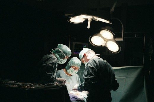 Stock Photo: 824-14239 SURGICAL TEAM. SURGICAL TEAM Photo essay for press only. Operating room.