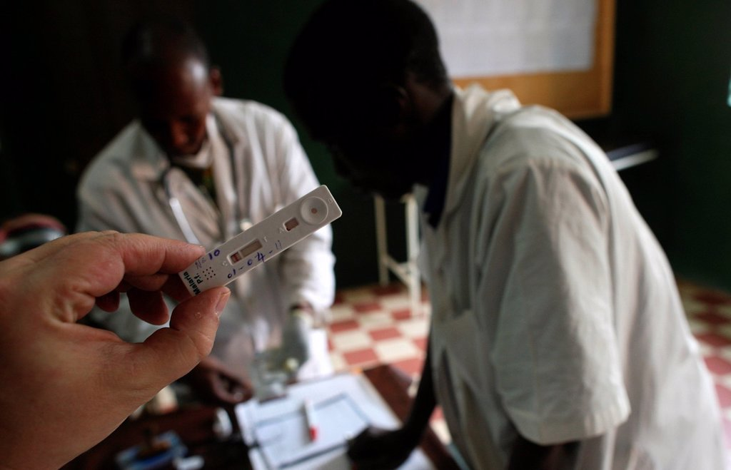 Stock Photo: 824-14688 MALARIA TEST. Photo essay in a free clinic in Mali. Blood test to diagnose malaria. WHO, UNICEF.