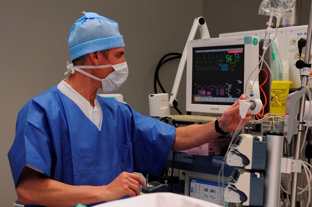 Stock Photo: 824-16540 ANESTHETIST. Photo essay at Lyon hospital. Department of urology. Surgical treatment of erectile dysfunction with a penile prosthesis.