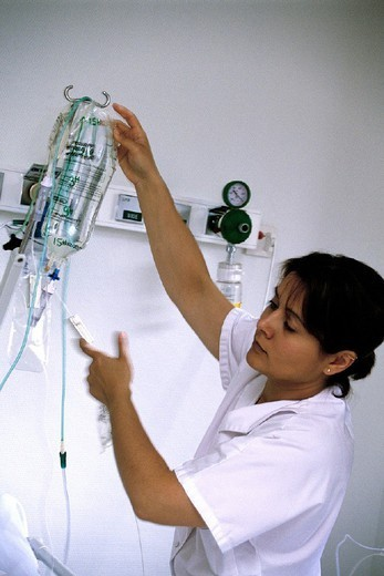 Stock Photo: 824-17375 DRIP. DRIP Photo essay. Chatellerault Hospital (Camille Guérin Hospital) in the French department of Vienne. Nurse preparing an IV drip.