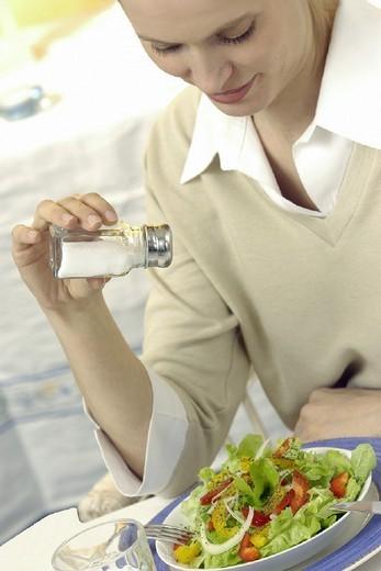 WOMAN EATING SALAD. WOMAN EATING SALAD Model. : Stock Photo