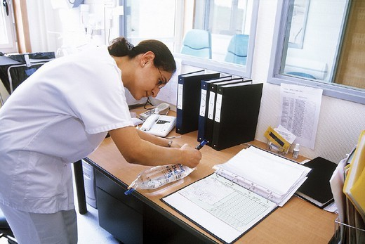 Stock Photo: 824-19815 NURSE DISPENSING DRUGS. NURSE DISPENSING DRUGS Photo essay. Chatellerault Hospital (Camille Guérin Hospital) in the French department of Vienne.