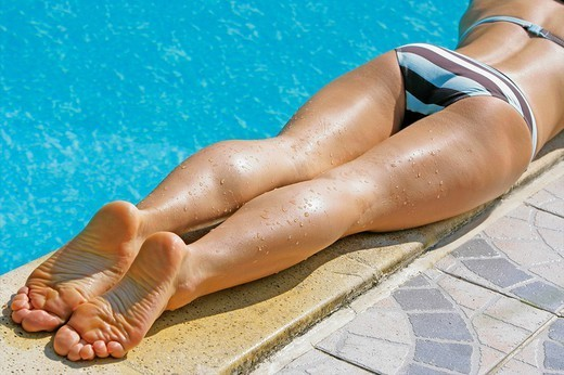 WOMAN TANNING IN SUMMER. WOMAN TANNING IN SUMMER Model. : Stock Photo
