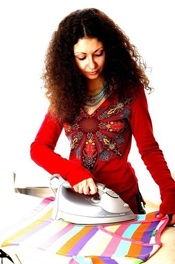 WOMAN DOING HOUSEWORK. WOMAN DOING HOUSEWORK Worldwide distribution except for South Africa : Stock Photo