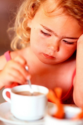 CHILD WITH HOT DRINK. CHILD WITH HOT DRINK Worldwide distribution except for South Africa : Stock Photo