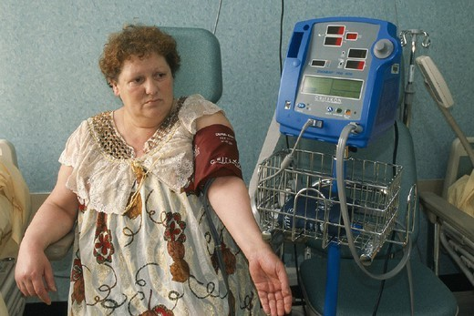 Stock Photo: 824-22846 OBESITY, TREATMENT. OBESITY, TREATMENT Photo essay from hospital. Bichat Claude Bernard Hospital in Paris, France. Out-patient hospitalization. Measuring blood pressure.