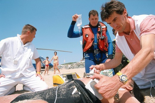 HEART DEFIBRILLATOR. Photo essay. Emergency medical service on the beach. The medical team uses a defibrillator in cases of cardiac arrest. : Stock Photo