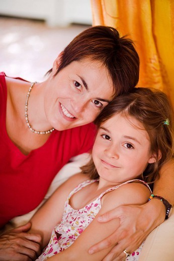 MOTHER & CHILD. MOTHER & CHILD Models. 8_year_old girl. : Stock Photo