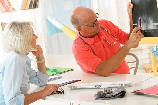 ELDERLY PERSON CONSULT BACK PB. Models. : Stock Photo