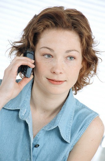 WOMAN TELEPHONING. WOMAN TELEPHONING Model. : Stock Photo
