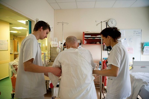 ELDERLY P. IN PHYSICAL THERAPY. Photo essay from La Croix Saint_Simon Hospital, Paris, France. Department of resuscitation. Walking exercises with the physical therapists. : Stock Photo
