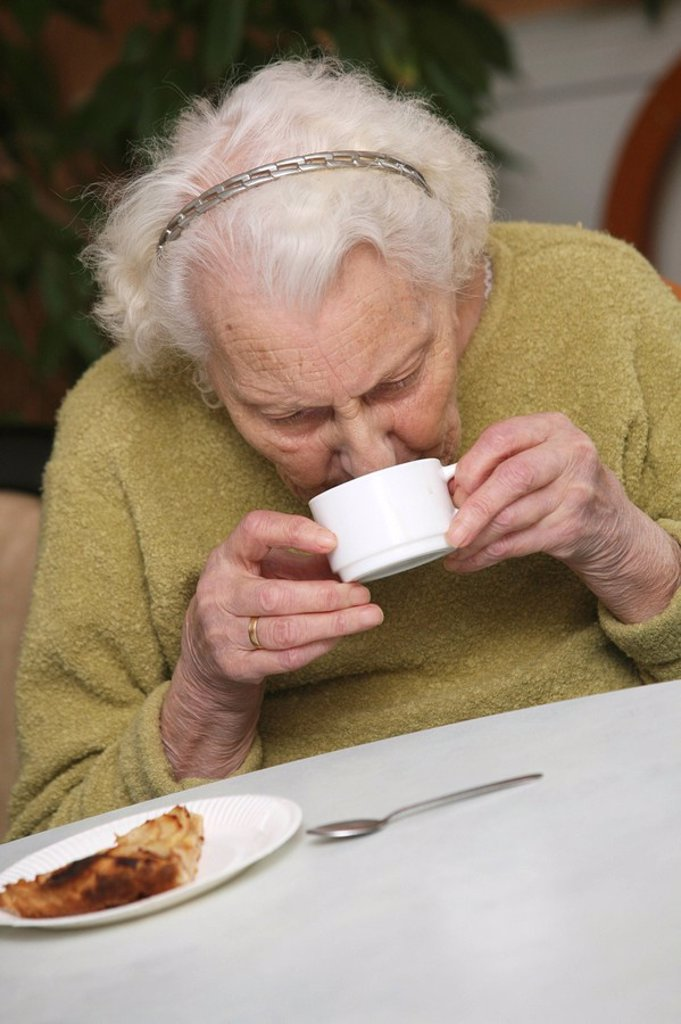 Stock Photo: 824-30808 HOME FOR THE AGED. HOME FOR THE AGED Photo essay in a nursing home for the elderly in the department of Aisne, France. Retired woman having her afternoon tea.
