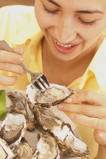 WOMAN EATING FISH. WOMAN EATING FISH Model. : Stock Photo