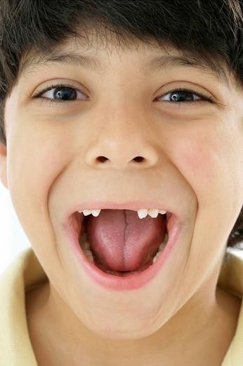 LOSING MILK TEETH. LOSING MILK TEETH Model. 7_year_old boy. : Stock Photo