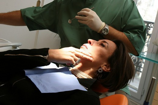 Stock Photo: 824-34432 WOMAN RECEIVING DENTAL CARE. WOMAN RECEIVING DENTAL CARE Photo essay from dental office. Dentist´s office.