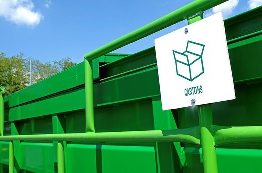 RECYCLING CARDBOARD. Municipal waste collection centre. : Stock Photo