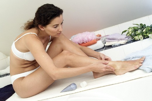 BODY CARE, WOMAN. BODY CARE, WOMAN Model. Treatment for lower leg edema. : Stock Photo